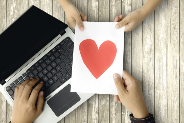 laptop and a heart signifying relationship between brand and micro influencer