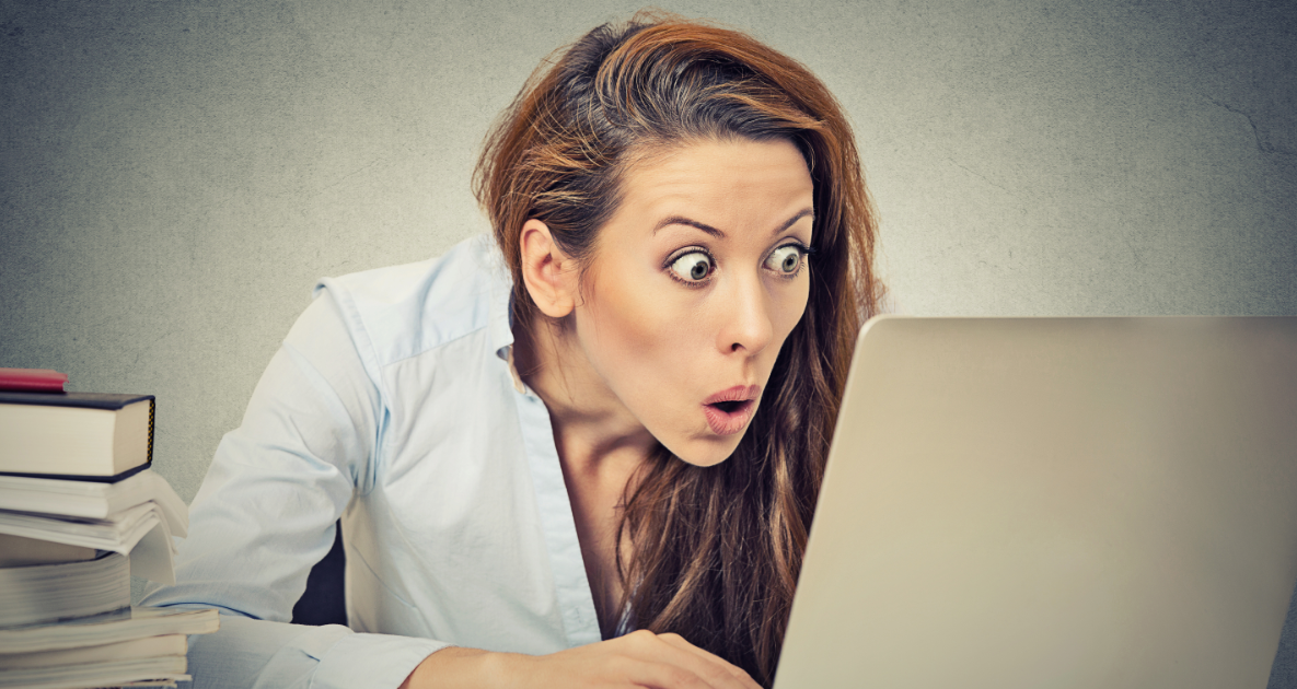woman shocked reading business blog